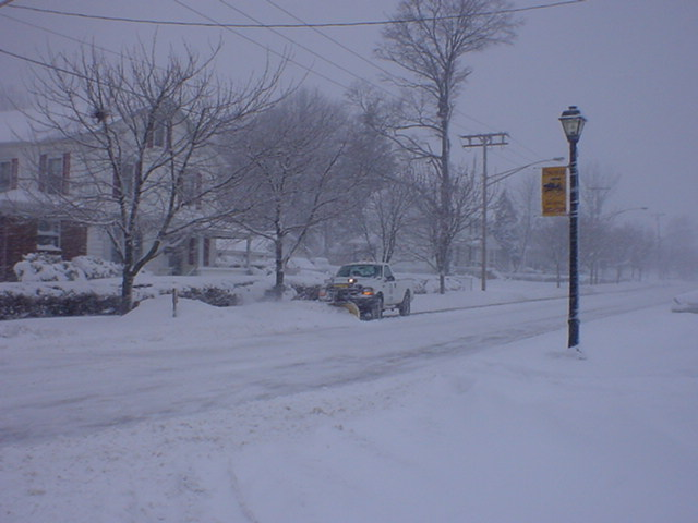 An Unidentified Borough Worker and Plow Clear Snow from West Railroad Avenue.