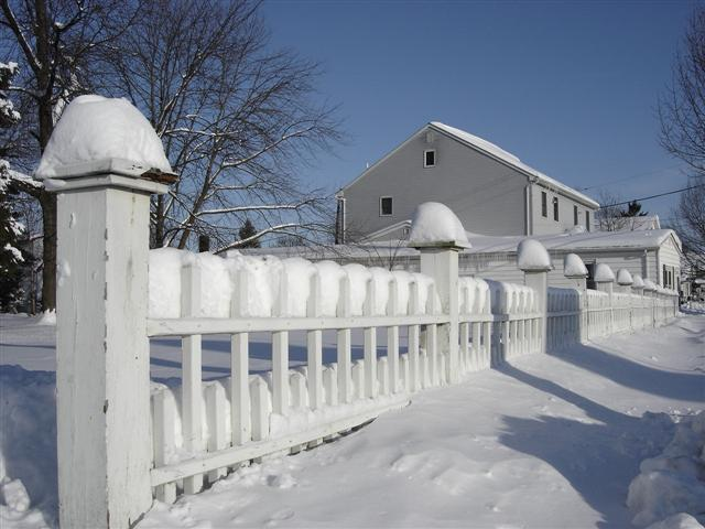 Snow on Victorian Open Picket Fence.