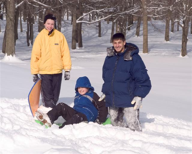 Father and Sons Sledding in Thompson Park.  Credit, Bernie Photos
