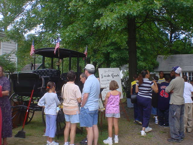 Visitors View the Lincoln Coach
