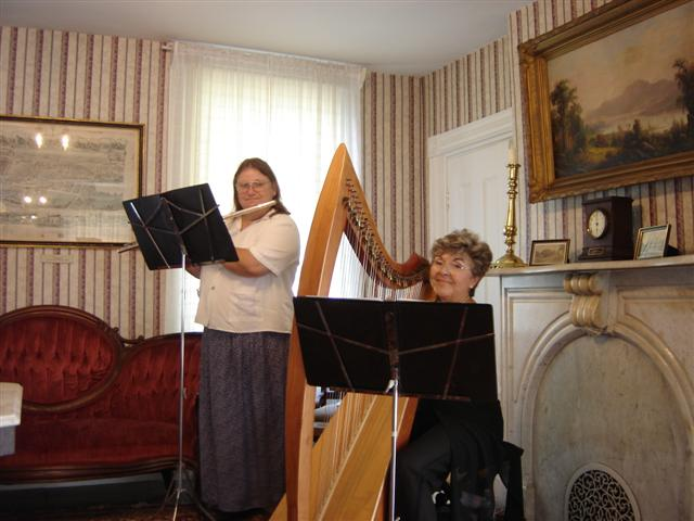 The harp and flute serenaded visitors