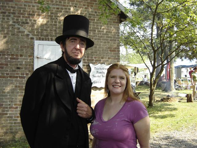 Abe Lincoln poses with a guest