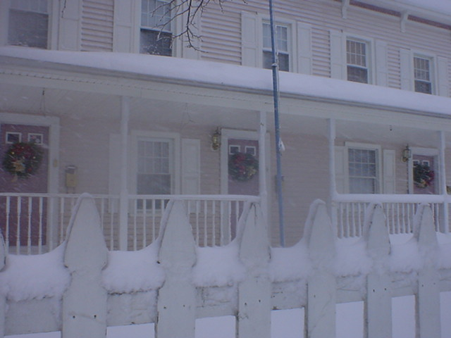 A Private Residence Decorated with Wreaths in the Snow.