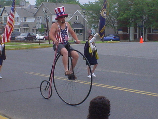 A Patriotic Man on an Old-Fashioned Bike