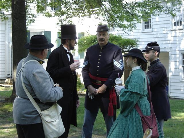At Buckelew Mansion President Lincoln speaks with fellow soldiers and civilians.
