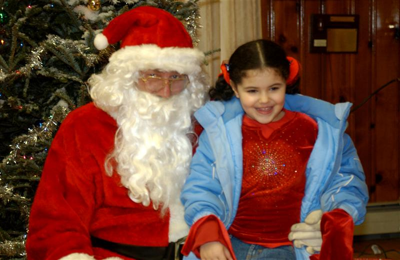 Young girl with Santa.